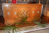 The palm leaves lay quietly at the foot of the Altar