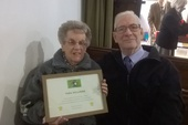 Vera and husband Mick with the certificate of thanks...