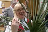 Revd Julie practising with the palms